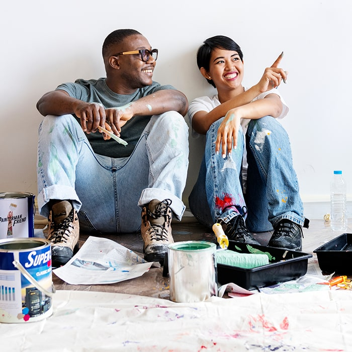 Young Couple Painting Home