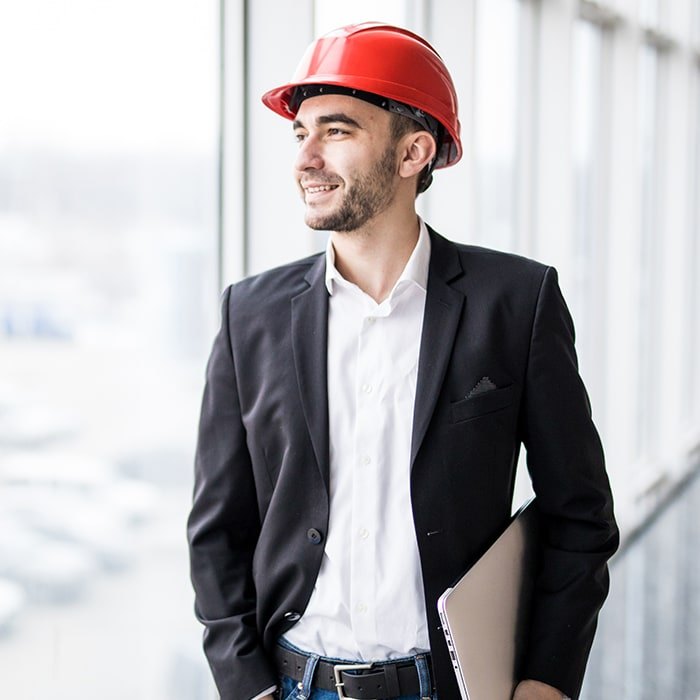 Businessman wearing hardhat