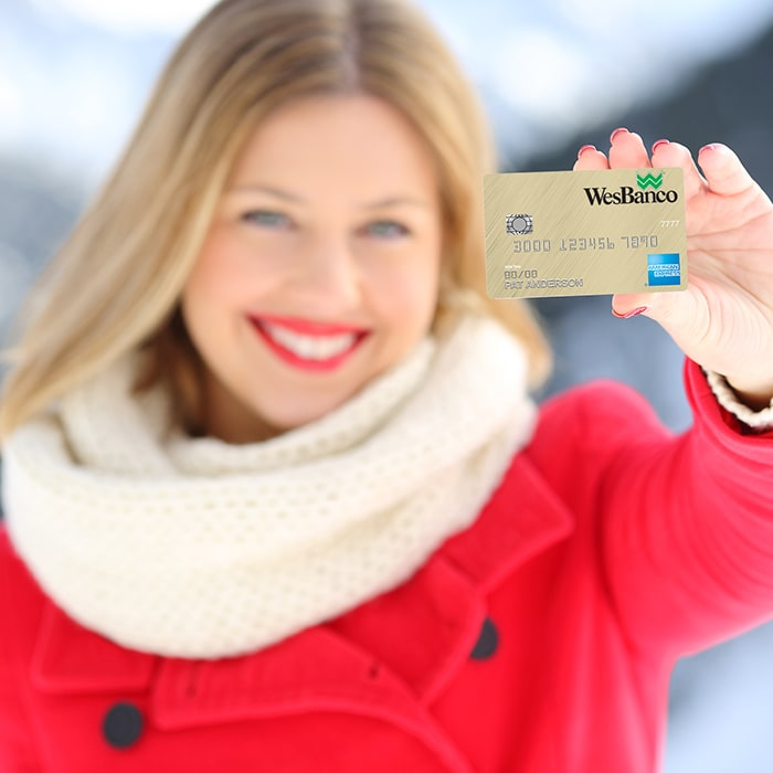 Person holding a WesBanco credit card