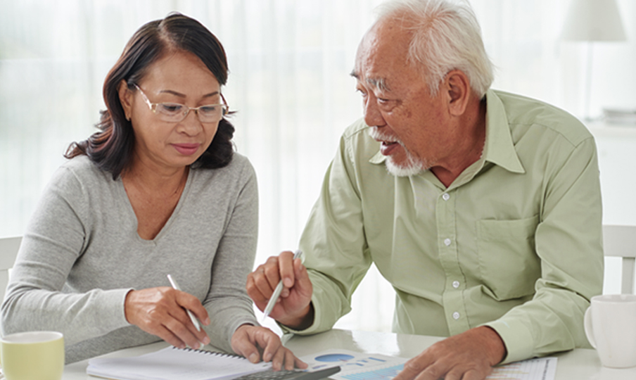 Elderly couple working on documents