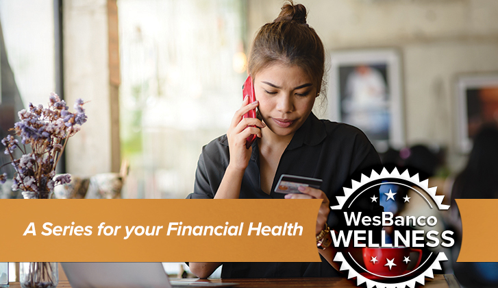 A young woman on the phone frowns down to the financial card in her hand. The words A Series for your Financial Health in orange banner in the foreground.