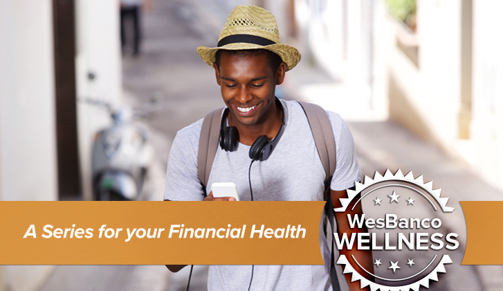 A young man with a hat looks at his cell phone while he walks. The words A Series for your Financial Health in orange banner in the foreground.