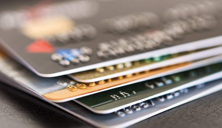 Detailed focus of a stack of financial cards.