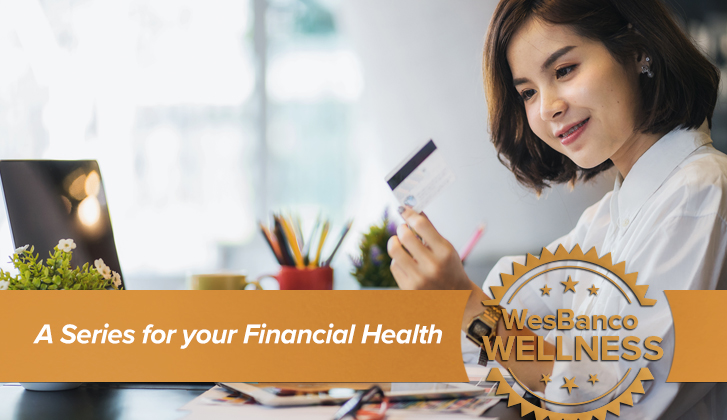 Young woman looking at a financial card. The words A series for your Financial health in orange banner in the foreground
