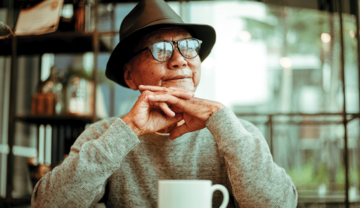 Elderly man with coffee cup