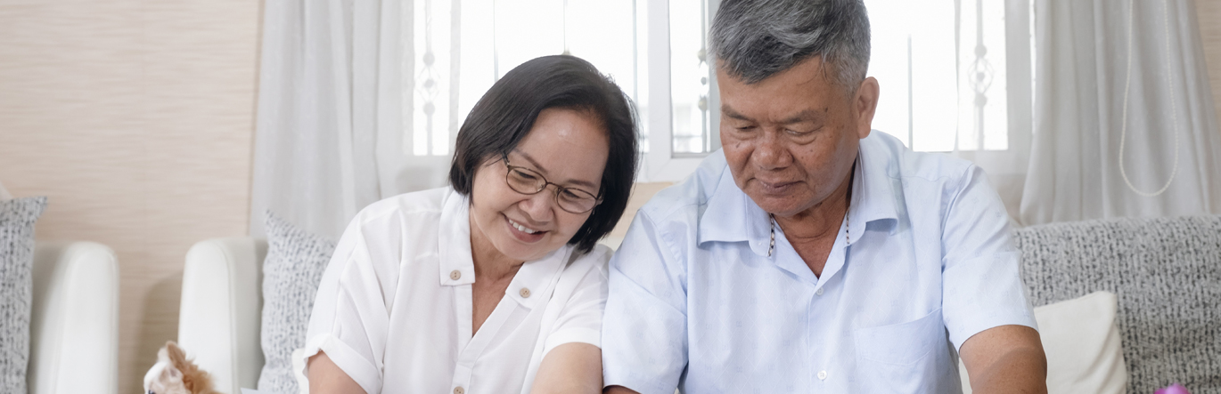 Asian couple going through documents